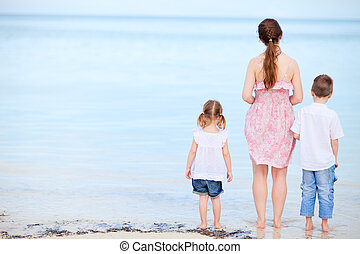 Mother and two kids on a beach