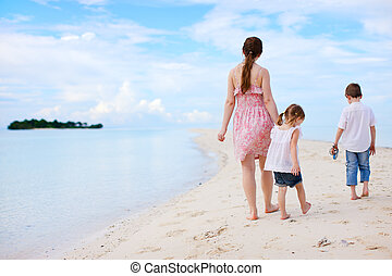 Mother and two kids on beach