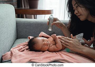 mother applying eucalyptus oil to her little daughter