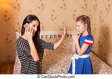 Mother asks the daughter to keep silent.