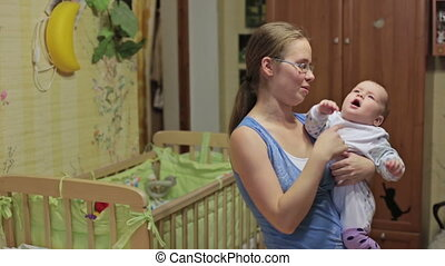 Mother at home with baby