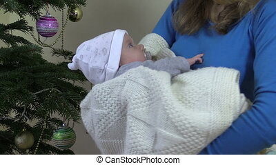 mother baby christmas - Closeup of mother mom cradle sway...