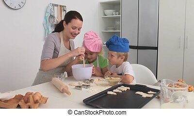 Mother baking with her children