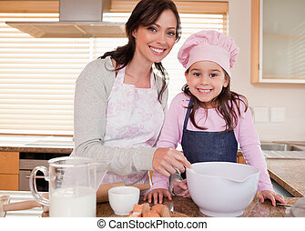 Mother baking with her daughter