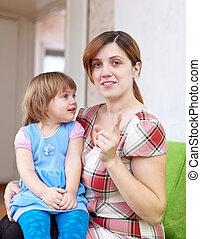 Mother berates her child in interior