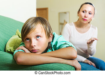 Mother berating teenager son