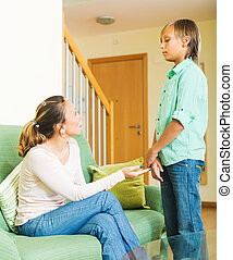 Mother berating teenager son - Ordinary mother berating...