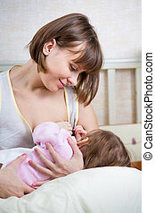 mother breast feeding her kid