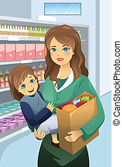 Mother carrying her daughter and grocery bags
