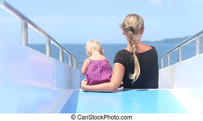 mother child ship ocean - mother with a child sitting on the...