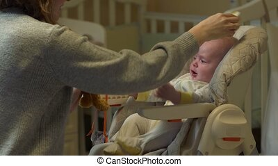 Mother Combing A Baby