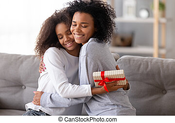 Mother congratulating daughter with birthday people hugging