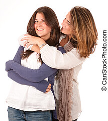Mother cuddling her teen daughter