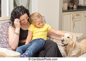 Mother, daughter, and dog - Mother and daughter sitting...