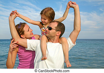 Mother, daughter and father on the sea