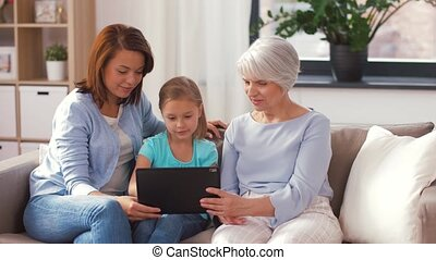 mother, daughter and grandmother with tablet pc - family,...
