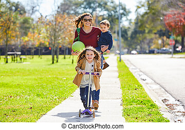 Mother daughter and son family in the park