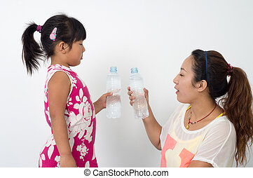 Mother daughter drink mineral water