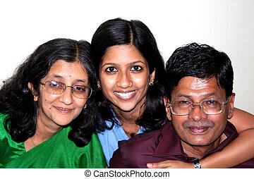 Mother Daughter & Father - A cute portrait of an Indian...