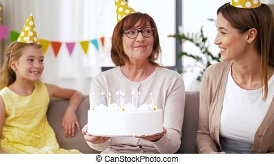 mother, daughter, grandmother with birthday cake - family, ...