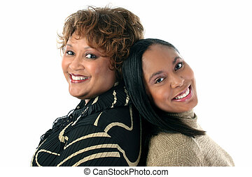 Mother Daughter - Mother and Daughter back to back. Close-up...