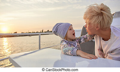 Mother, daughter on yacht or catamaran boat. Concept of the ...