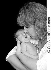 Mother Daughter - Mother Kissing Her Newborn Daughter
