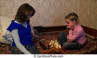 mother daughter play chess
