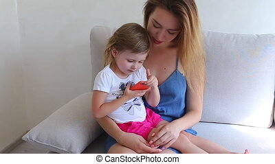 Mother daughter play use phone and family concept hugs -...
