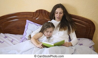Mother daughter reading a fairy tale