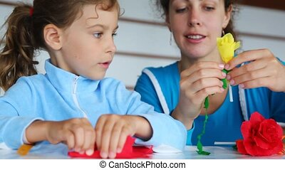 mother does for daughter flower of color paper at table