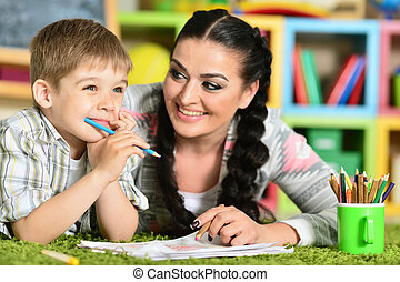mother drawing with little son