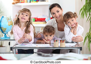 Mother drawing with three daughters