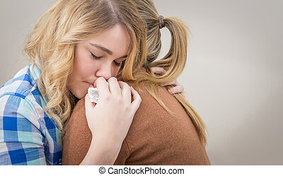 Mother embracing and soothes depres