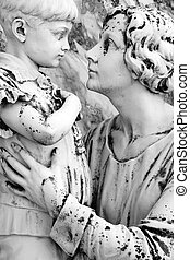 mother embracing little boy - cemetery statue detail, Italy