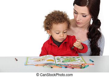 Mother encouraging creative toddler