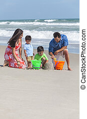 Mother Father & Children Family Playing on Beach