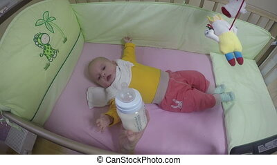 mother feed baby bottle