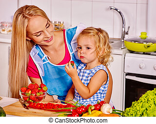 Mother feed child at kitchen. - Mother feed happy child at ...