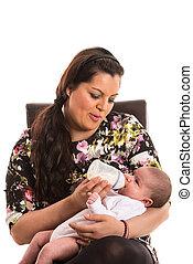 Mother feed newborn baby