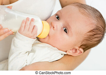 Mother feeding her 3 months old baby from bottle