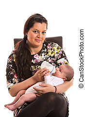 Mother feeding her newborn baby