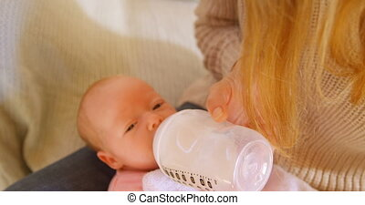 Mother feeding milk to her baby boy 4k