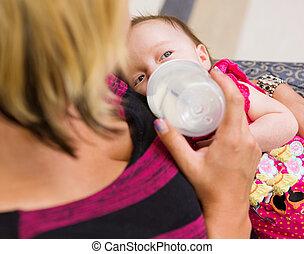 Mother Feeding Milk To Newborn Baby Girl