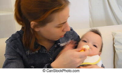 mother feeds baby