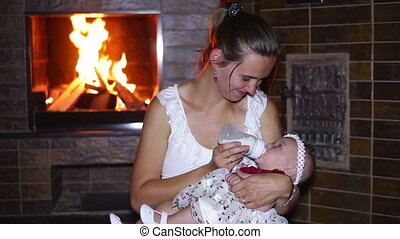 mother feeds her baby