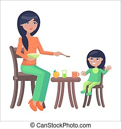 Mother Feeds her Little Daughter, Sitting at Table - Young...