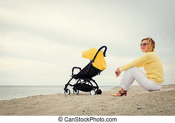 Mother gets some rest on beach