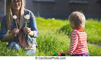 mother give blowballs her little daughter