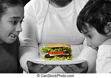 Mother giving a burger to son and daughter